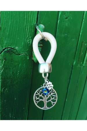 white leather keyring with tree