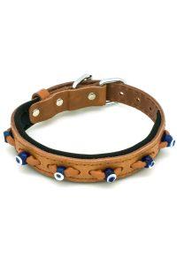 beige dog collar with evil eyes