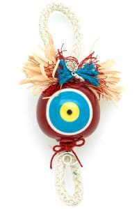 good luck charm with large red evil eye