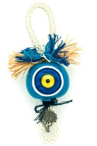 good luck charm with large light blue evil eye