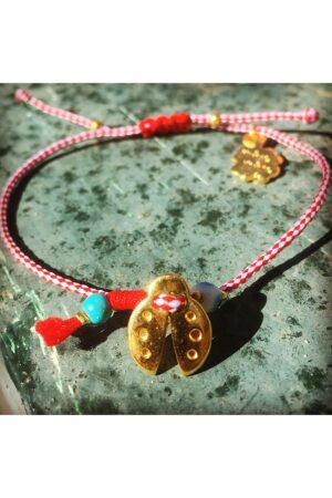 bracelet for March with ladybird