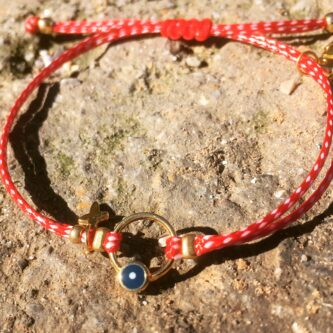 bracelet for March with evil eye and cross