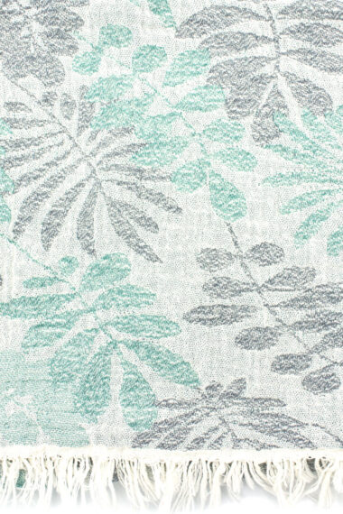 beach towel with subtle green leaves