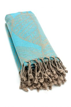turquoise beach towel with brown leaves