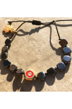 bracelet with large hematite beads and evil eye
