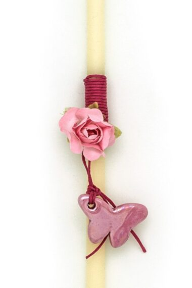 candle for Easter with flower and fuchsia butterfly