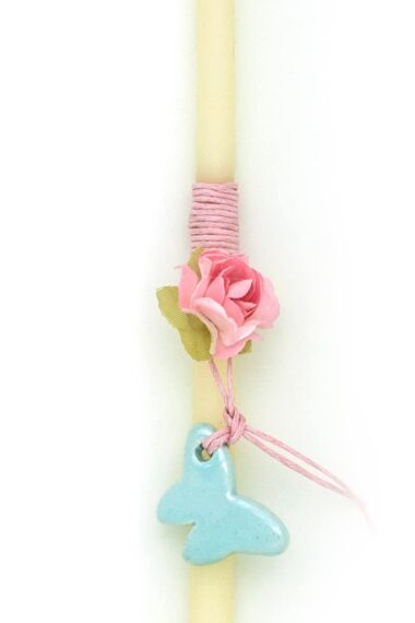 candle for Easter with flower and light blue butterfly