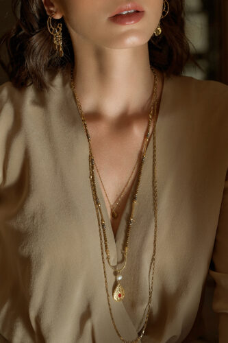 long multi-series necklace with gold-plated pendants