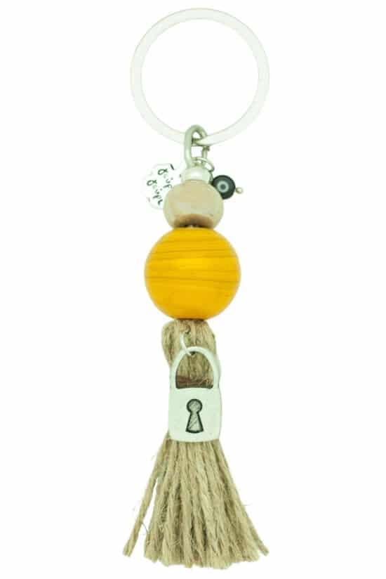 keyring with large mustard yellow bead and padlock