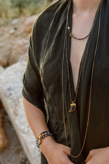 long multi-series summer necklace with black tooth
